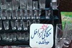 حکاکی آیات قرآن بر روی شیشه در مهدیشهر