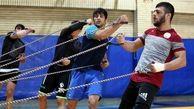 تمرینات آزادکاران در محل آکادمی ملی المپیک در حال برگزاری است