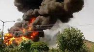 آتش سوزی مهیب در پارکینگ خودروهای سنگین کرمانشاه